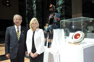 Mayor Crombie and Mayor Takenaka stand next to their gifts