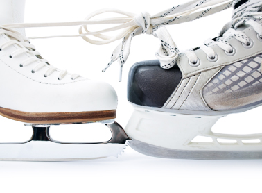Figure skate and a hockey skate with their laces tied together in a bow