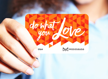 Girl holding a gift card that reads do what you love