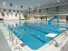Interior of pool showing diving board and slide