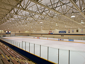 Interior of the arena showing empty ice surface and stands